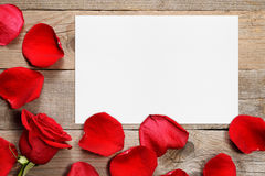 Red rose petals and greeting card Royalty Free Stock Images