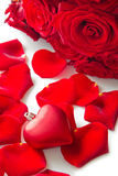 Red rose petals with heart Royalty Free Stock Photography