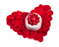 Red rose petals heart with gift box. Isolated on white background Royalty Free Stock Photography