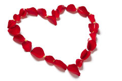 Red rose petals in heart shape royalty free stock image