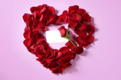 Red rose petals in heart shape Royalty Free Stock Photo