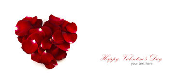 Red rose petals in a heart shape isolated Royalty Free Stock Images