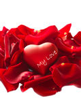 Red rose petals with heart. Some Red rose petals with heart Stock Photography