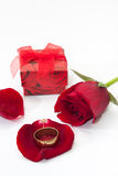Red rose petals with red gift box and golden ring Royalty Free Stock Photos