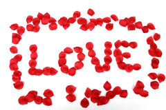Red rose petals spell love Royalty Free Stock Photography