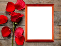 Red rose and photo frame Stock Photos