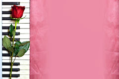 Red rose and piano keys on grunge background Royalty Free Stock Photography