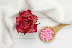 Red rose and pink bath salt Stock Photo
