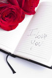 Red rose on planner. I love you writte on it Stock Photo