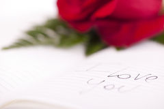 Red rose on planner. I love you writte on it Stock Image