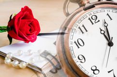 Red Rose and a pocket watch with diary. Stock Photo