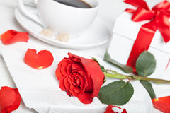 Red rose, present box and coffee Royalty Free Stock Image
