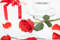 Red rose, present box and cup of coffee Royalty Free Stock Photo