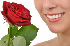Red rose and a radiant smile Stock Images