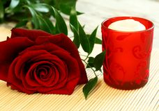 red rose and red candle Stock Images