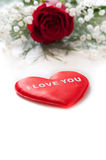 Red rose with a red heart Royalty Free Stock Photo
