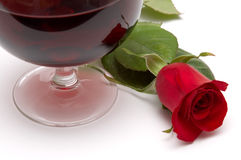 Red rose reflection. Beautiful red rose reflection on a red wine glass Royalty Free Stock Photography