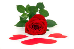 Red rose rests with three hearts Stock Photo