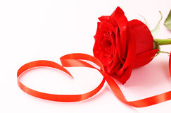Red rose  with a ribbon in the form of heart Stock Image