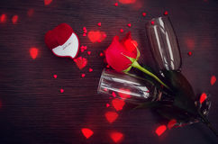 Red rose, ring, hearts and champagne glasses Royalty Free Stock Photo