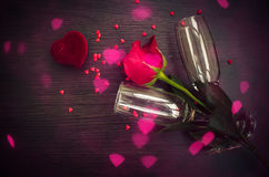 Red rose, ring, hearts and champagne glasses Royalty Free Stock Images