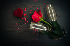 Red rose, ring, hearts and champagne glasses Royalty Free Stock Image