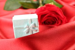 Red rose on satin background Stock Images