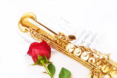 Red rose, saxophone and notes Stock Photos