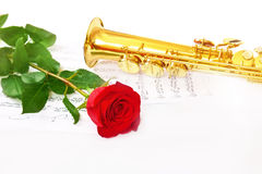 Red rose, saxophone and notes Stock Images