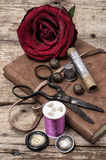 Red rose and sewing accessories and tools Royalty Free Stock Image