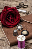 Red rose and sewing accessories and tools Royalty Free Stock Photography