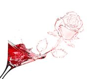 Red rose splash from martini Royalty Free Stock Photo