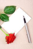 Red rose and stationery Stock Images