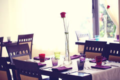 Red rose on table in a restaurant Stock Photography