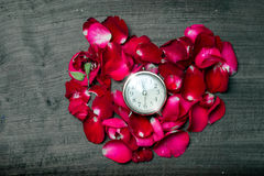 Red rose on time. Red rose and flower leaf heart shape on time clock runing out Royalty Free Stock Image