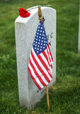 Red Rose on tombstone. American flag and Red Rose on a veterans tombstone at an American National Cemetery Stock Photography