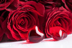 Red rose and two hearts, focus on the foreground Royalty Free Stock Photo