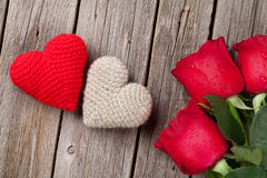 Red rose and Valentines day hearts on wood Royalty Free Stock Image