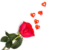 Red rose on a white background and randomly the scattered red gl Stock Photo