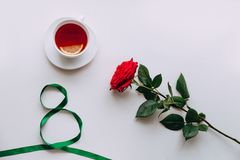 Red Rose on a white background, ribbon by March 8 stock image