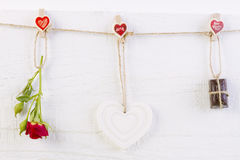 Red rose with white shape heart and chocolate on white Stock Photography