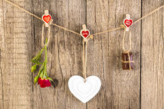 Red rose with white shape heart and chocolate on wood. Stock Image