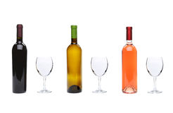 Red, rose, white wine bottles and glasses Royalty Free Stock Image