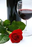 Red rose and wine. Dinner setting with red rose and red wine Royalty Free Stock Photos