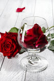Red rose and wineglass Royalty Free Stock Image