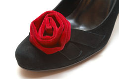 Red rose on woman black shoe Stock Photo