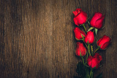 Red rose on wooden Stock Images