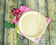 Red rose and wooden plate on wooden table Stock Images