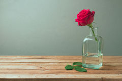 Red rose on wooden table for Mother's Day celebration. Over retro background Royalty Free Stock Photography