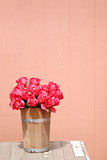Red rose in wooden vase. Stock Images